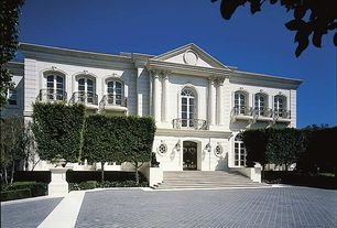 Traditional Exterior of Home with Corinthian column, Arch window, Deck Railing, Pathway, Arched window, Balcony