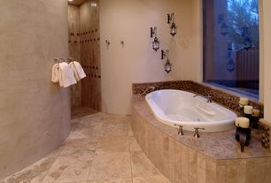Mediterranean Master Bathroom with Wall sconce, Master bathroom
