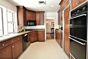 Traditional Kitchen with Complex granite counters, limestone tile floors, flush light, U-shaped, Flat panel cabinets, Flush