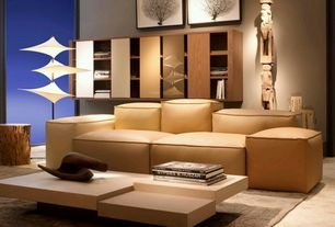 Contemporary Living Room with Concrete floors, Built-in bookshelf