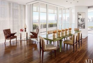 Contemporary Dining Room with Standard height, can lights, French doors, Hardwood floors, picture window