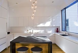 Contemporary Kitchen with Corian counters, can lights, Kitchen island, High ceiling, specialty window, full backsplash, Flush