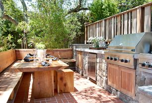 Craftsman Patio with Outdoor kitchen, Exterior brick flooring, Fence, Macys Champagne Dining Table