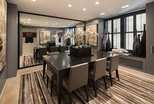 Contemporary Dining Room with double-hung window, can lights, Standard height, Window seat, Laminate floors, flush light