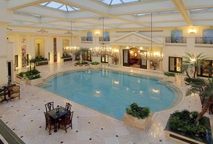 Traditional Swimming Pool with Deck Railing, Glass panel door, Indoor pool, Skylight, Raised beds, exterior stone floors