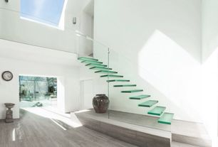 Modern Staircase with Custom staircases and railing systems by marretti, Indoor/outdoor, Floating stairs, Laminate floors
