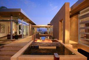 Modern Patio with Pond, Floor to ceiling windows, French doors, Poured concrete steps, Fire pit, Exterior stucco walls