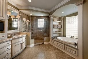 Traditional Master Bathroom with Crown molding, frameless showerdoor, Silestone - Kona Beige, Handheld showerhead, Limestone
