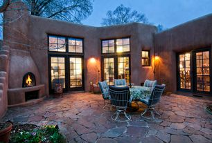 Rustic Patio with Transom window, exterior stone floors, sliding glass door, Raised beds, double-hung window, Fence