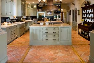 Country Kitchen with Glass panel door, double wall oven, Raised panel, Island Hood, terracotta tile floors, full backsplash