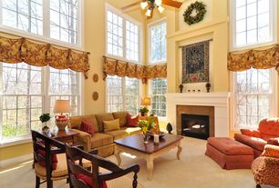 Traditional Living Room with stone fireplace, Carpet, High ceiling, Ceiling fan