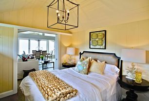 Contemporary Guest Bedroom with High ceiling, Hardwood floors, Dennison lantern currey, Upholstered headboard, French doors