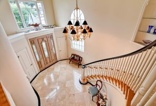 Traditional Staircase with Laminate floors, Built-in bookshelf, Arched window, High ceiling