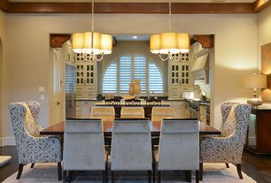 Contemporary Dining Room with Exposed beam, Pendant light, Hardwood floors, Cement fireplace