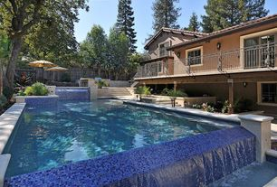 Modern Swimming Pool with French doors, Pathway, Fence, exterior stone floors, Infinity pool, Outdoor kitchen