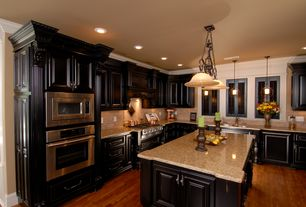 Traditional Kitchen with Simple granite counters, Interior plantation shutters, Custom hood, Limestone Tile, Kitchen island