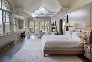 Contemporary Master Bedroom with stone fireplace, Wood panel wall, Transom window, can lights, Arched window, High ceiling