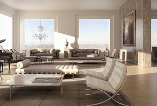 Modern Living Room with barcelona couch with black straps, Barcelona chair chrome plated, Laminate floors, Chandelier