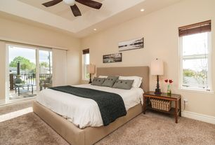 Contemporary Master Bedroom with Carpet, double-hung window, can lights, sliding glass door, Ceiling fan, Standard height
