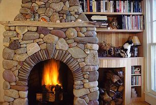 Rustic Library with Fireplace, double-hung window, stone fireplace, Built-in bookshelf, High ceiling, Hardwood floors