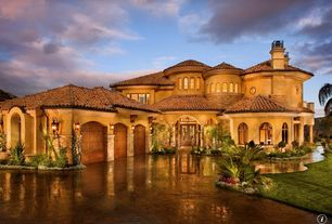 Mediterranean Exterior of Home with exterior stone floors, Glass panel door, Arched window