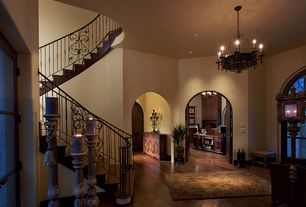 Mediterranean Entryway with can lights, six panel door, High ceiling, Arched window, Hardwood floors, Chandelier
