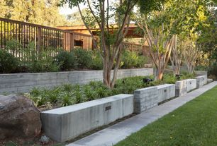 Contemporary Landscape/Yard with Fence, Pathway, Raised beds, exterior stone floors