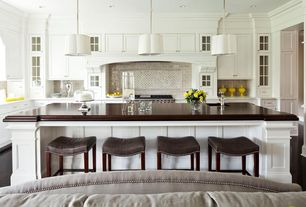 Contemporary Kitchen with Wood counters, Undermount sink, Flush, Breakfast bar, Custom hood, Glass panel, Pendant light