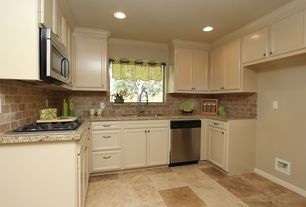 Country Kitchen with Dura Supreme Cabinetry Arcadia Panel, L-shaped, Tumbled marble subway tiles, Sandstone, Crown molding