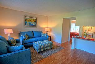 Modern Living Room with Crate And Barrel Verano Sofa, Hardwood floors, Standard height, Armstrong Hardwood Oak Gunstock
