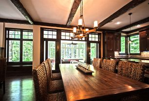 Craftsman Dining Room with Hardwood floors, Exposed beam, Chandelier, Transom window, French doors