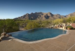 Rustic Swimming Pool with exterior stone floors, Fence, Raised beds, Other Pool Type