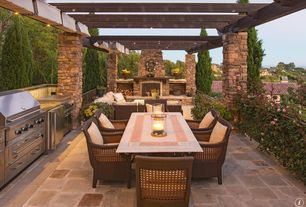 Craftsman Patio with outdoor pizza oven, Trellis, Outdoor kitchen, Pompeii 7-piece Wicker Dining Set, exterior stone floors