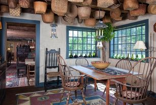 Eclectic Dining Room with Hardwood floors, Wall sconce, William and Mary bannister back side chair, Windsor Chair, Navajo rug