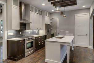 Traditional Kitchen with Pendant light, gas range, Multiple Sinks, Glass panel, specialty door, Stone Tile, Sandstone Tile