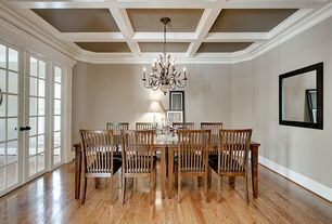 Traditional Dining Room with French doors, Crown molding, Currey & company arcadia chandelier, Chandelier, Exposed beam