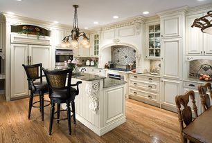 Traditional Kitchen with Raised panel, L-shaped, Pendant light, Crown molding, Breakfast nook, Kitchen island, Limestone Tile