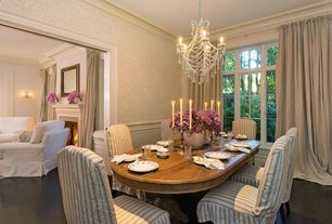 Traditional Dining Room with Chandelier, Concrete floors