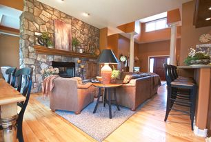 """Rustic Living Room with Columns, TMS Paloma 30"""" Bar Stool, Paint1, Hillsdale Montclair End Table, paint2, High ceiling"""