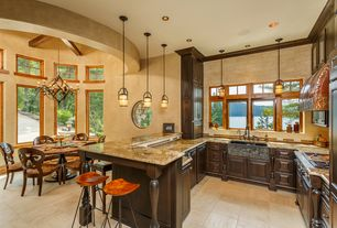 Rustic Kitchen with Raised panel, travertine tile floors, Complex marble counters, Farmhouse sink, Pendant light, Stone Tile
