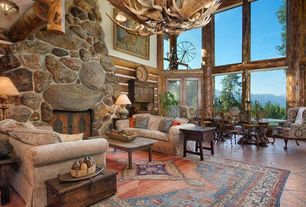 Rustic Living Room with slate floors, flush light, Standard height, Moose 10 antler chandelier, stone fireplace, Chandelier