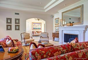 Traditional Living Room with stone tile floors, Crown molding, Cement fireplace, Fireplace, High ceiling, can lights