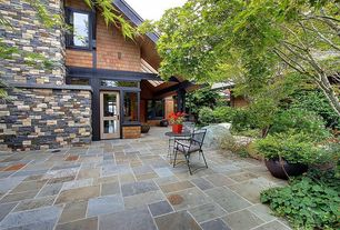 Traditional Patio with French doors, Raised beds, exterior stone floors