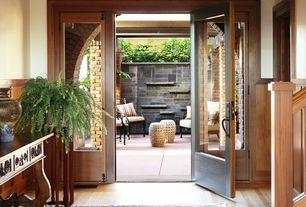 Traditional Entryway with Wainscotting, Laminate floors, Glass panel door, Built-in bookshelf