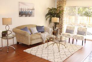 Contemporary Living Room with Hardwood floors, sliding glass door, picture window, Standard height
