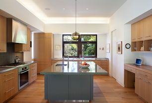 Contemporary Kitchen with Pendant light, European Cabinets, flat door, wall oven, flush light, full backsplash, Wood counters