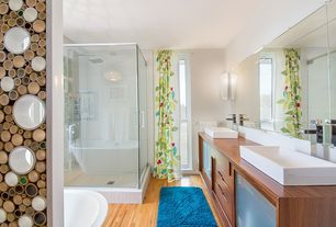 Contemporary Master Bathroom with Master bathroom, Flat panel cabinets, Bathtub, Hardwood floors, frameless showerdoor, Flush