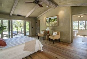 Rustic Master Bedroom with specialty door, Casement, Exposed beam, Ceiling fan, Hardwood floors, flush light, Pendant light