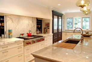 Contemporary Kitchen with Complex Marble, Kitchen island, Glass panel door, sandstone tile floors, Built-in bookshelf