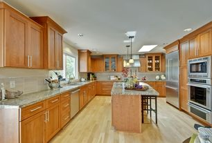 Craftsman Kitchen with Travertine Tile, Stone Tile, Breakfast bar, U-shaped, Undermount sink, Simple granite counters, Flush